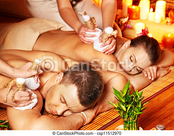 Man and woman getting herbal ball massage in spa. - csp11512970