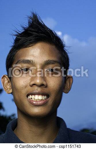 Malay teen smiling - csp1151743. Malay teen smiling with blue sky. Save Comp
