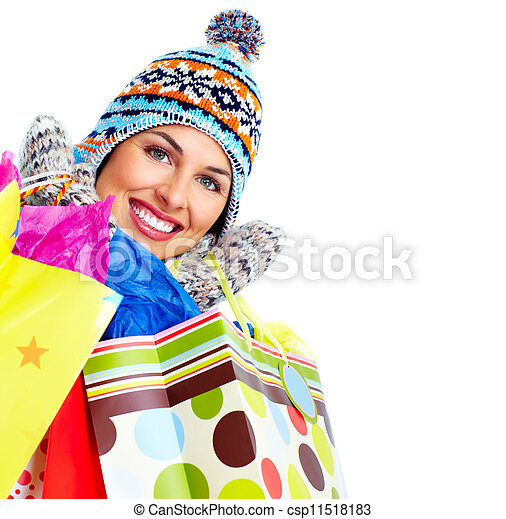 Beautiful shopping Christmas woman with bags. - csp11518183