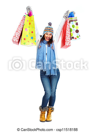Beautiful shopping Christmas woman with bags. - csp11518188