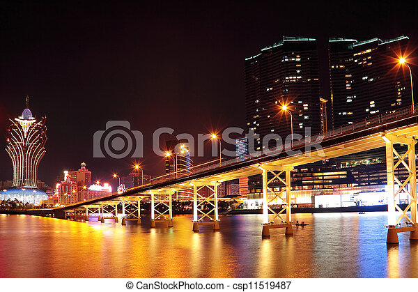 Macao cityscape with famous landmark of casino skyscraper and bridge - csp11519487