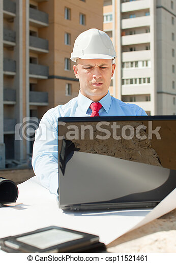 white-collar worker works on the building site