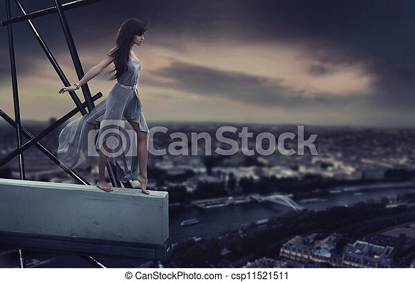 Beautiful woman standing on a cornice - csp11521511