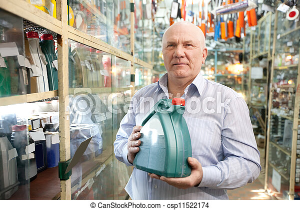 man buys automobile chemicals  - csp11522174