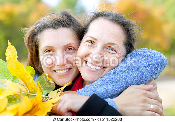 Happy  mature woman with adult daughter  - csp11522288
