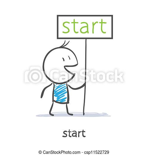 A man holds a sign start - csp11522729