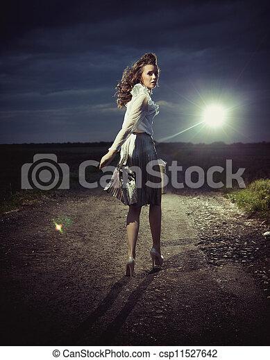 Beautiful woman walking away - csp11527642