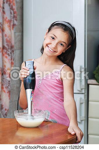 The girl mixed the dough