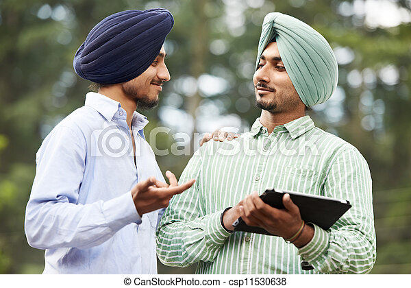 Young adult indian sikh men - csp11530638