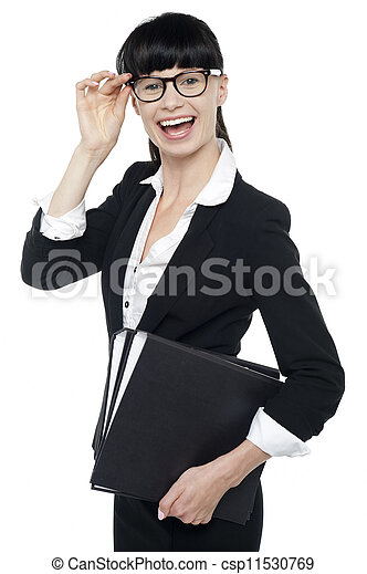 Cheerful female secretary carrying business files - csp11530769