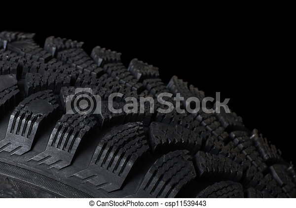 Automobile tire on black background - csp11539443