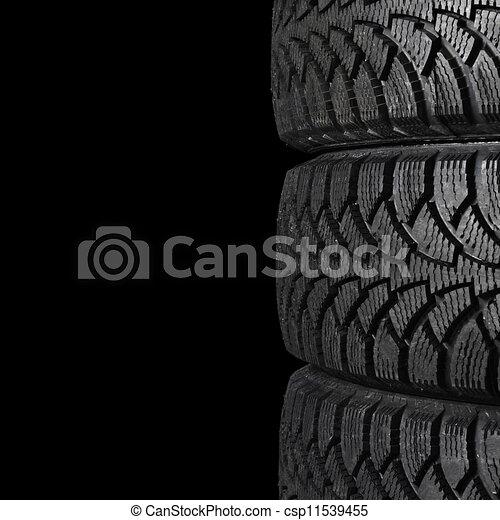 Automobile tire on black background - csp11539455