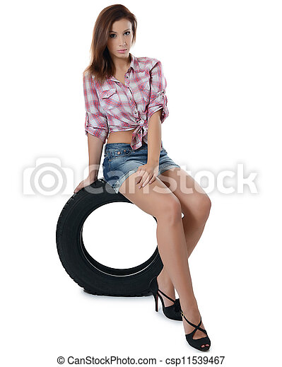 The girl with automobile tyres - csp11539467