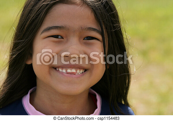 Smiling asian girl with toothy smile - csp1154483