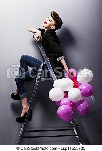 Pretty cheerful fashion retro teen girl laughing on ladder - csp11555785