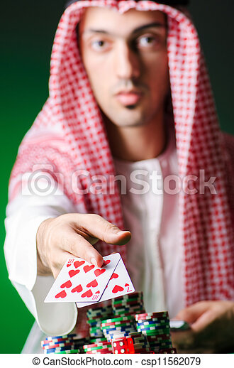 Arab playing in casino - gambling concept with man - csp11562079