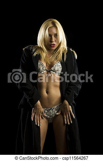 portrait of beautiful young woman in lingerie and coat  - csp11564267