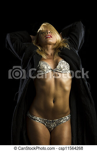 portrait of beautiful young woman in lingerie and coat - csp11564268
