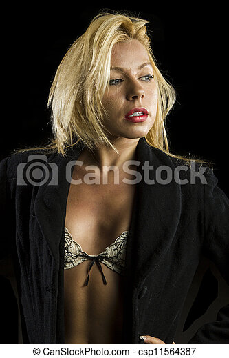 portrait of beautiful young woman in lingerie and coat  - csp11564387