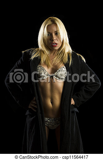 portrait of beautiful young woman in lingerie and coat - csp11564417