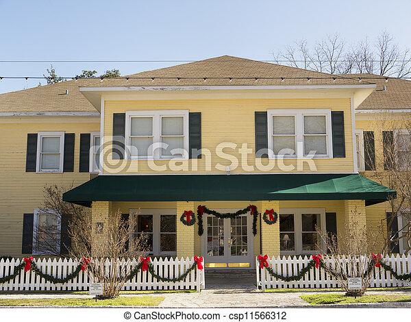 Historic Bed & Breakfast decked out for Christmas - csp11566312
