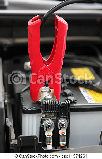 Jumper Cable connected to automobile car battery. - csp11574261