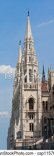 Panoramic steeple gothic revival style towers of Hungariuan governmant landmark Parliament by Imre Steindl in Budapest on blue sky background - csp11576787