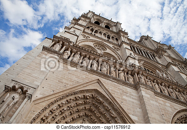 Famous landmark Gothic catholic cathedral Notre-dame on Cite island in Paris France on the blue and cloudy sky background - csp11576912