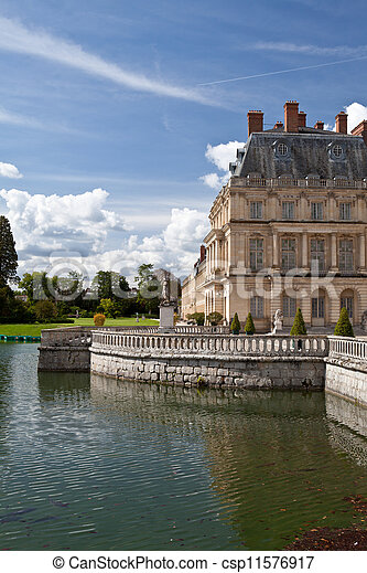 Medieval landmark royal hunting castle Fontainbleau near Paris in France and lake - csp11576917