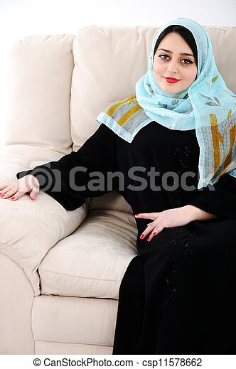Arabic woman sitting on sofa at home - csp11578662