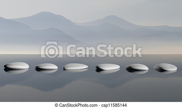 Scenic view of lake with mountain reflections and Zen stones in the water - csp11585144