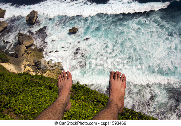 man at the edge of cliff - csp11593466
