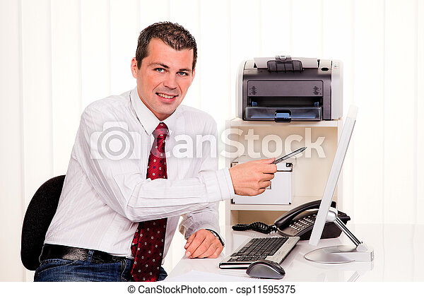 businessman in office with computer - csp11595375