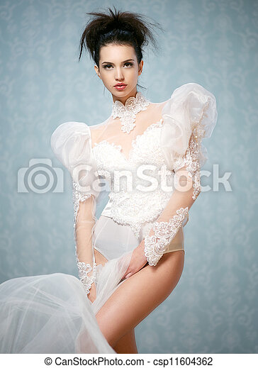 Young Caucasian woman posing in a sexy Victorian bodysuit - csp11604362