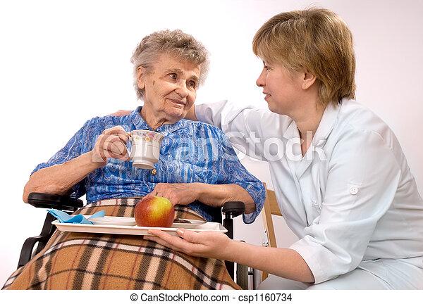 elderly woman in wheelchair - csp1160734