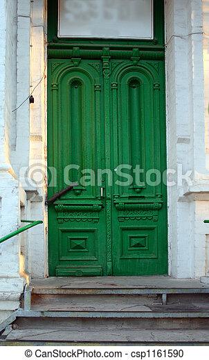 antiquarian green door - csp1161590