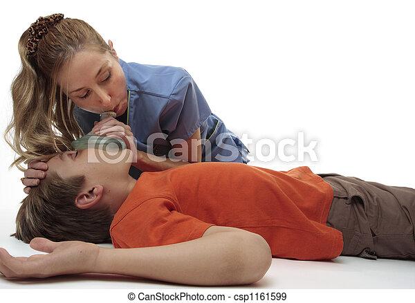 Resuscitating unconscious boy - csp1161599