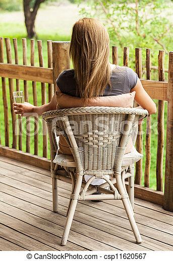 Stock beeld van veranda meisje aanzicht achterkant zittende foto van csp11620567 - Beelden van verandas ...