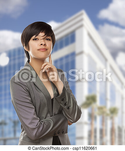 Mixed Race Young Adult in Front of Building - csp11620661