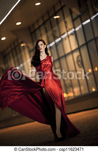 Sexy Young Beauty Woman In Fluttering Red Dress - csp11623471