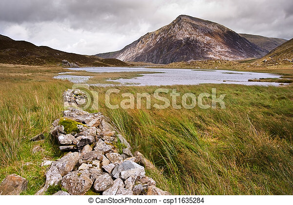View over Llynn Idwal in Glyderau mountain range in Snowdonia National Park towards Pen-yr-Ole-Wen in distance - csp11635284