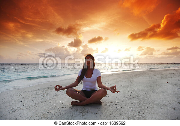 Yoga woman on beach at sunset - csp11639562