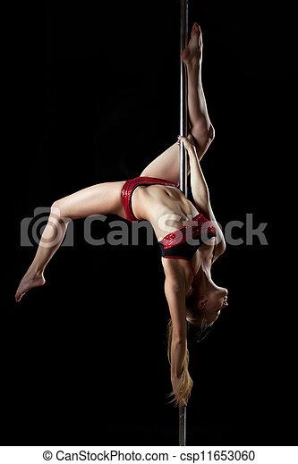 Young sexy pole dance woman in red bikini - csp11653060