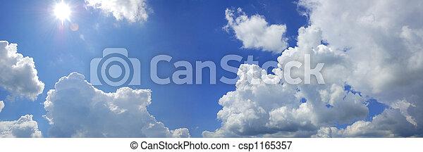 blue cloudy sky with sun panorama - csp1165357