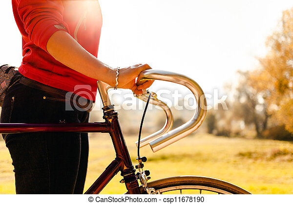 Woman cycling on bicycle in autumn park - csp11678190