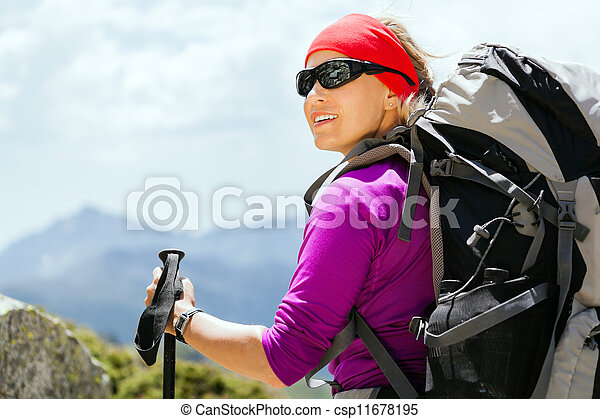 Woman hiking with backpack in mountains - csp11678195
