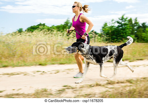Woman runner running, walking dog in summer nature - csp11678205