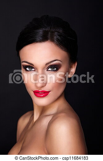 High fashion look.glamor closeup portrait of beautiful sexy Caucasian young woman model with red lips, bright makeup, with perfect clean skin isolated on black - csp11684183