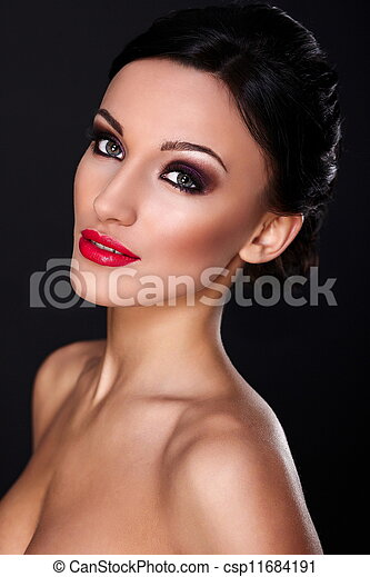High fashion look.glamor closeup portrait of beautiful sexy Caucasian young woman model with red lips,bright makeup, with perfect clean skin isolated on black  - csp11684191