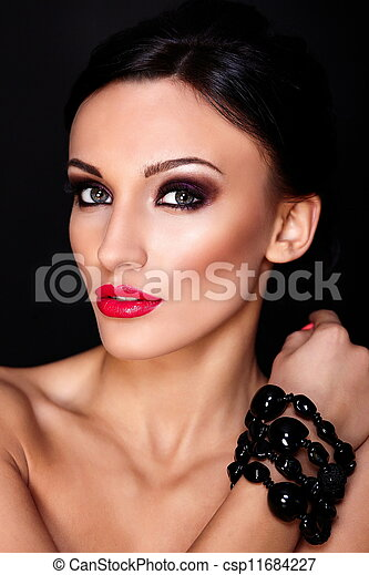 High fashion look.glamor closeup portrait of beautiful sexy Caucasian young woman model with red lips, bright makeup, with perfect clean skin isolated on black - csp11684227
